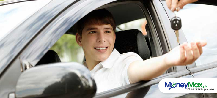 a young man riding on his car