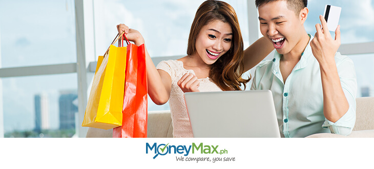 A man and a woman shopping online using credit card